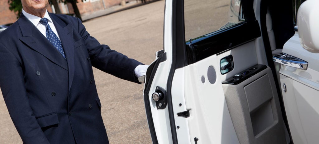 Smart City Prom Car Hire chauffeur opening door for student