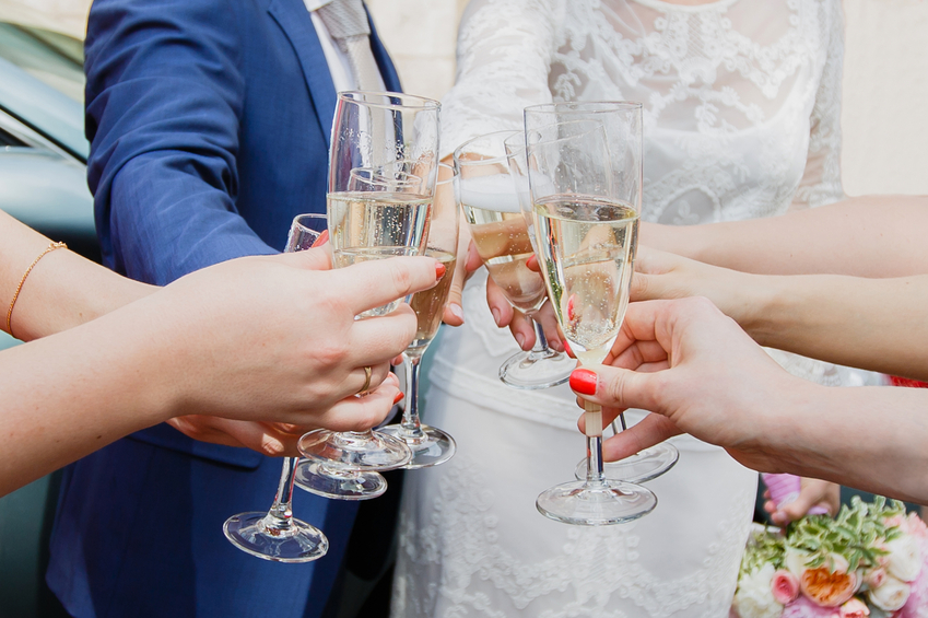 hands of young people toasting with champagne glasses